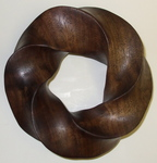 Claro Walnut Torus Knot, Figure 1